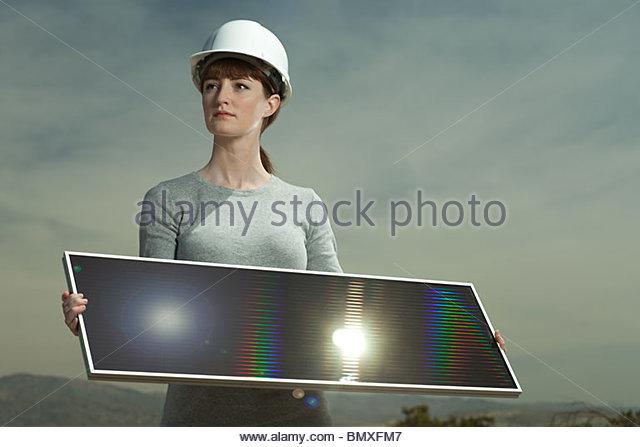 Woman holding solar panel - Stock Image