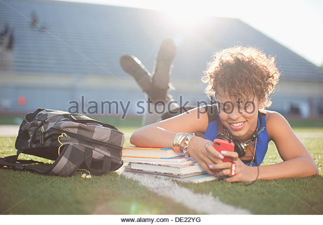 Woman listening to music - Stock Image