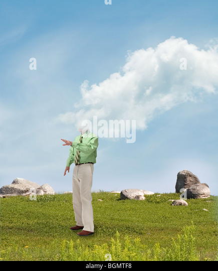 man in field overcome by cloud - Stock Image