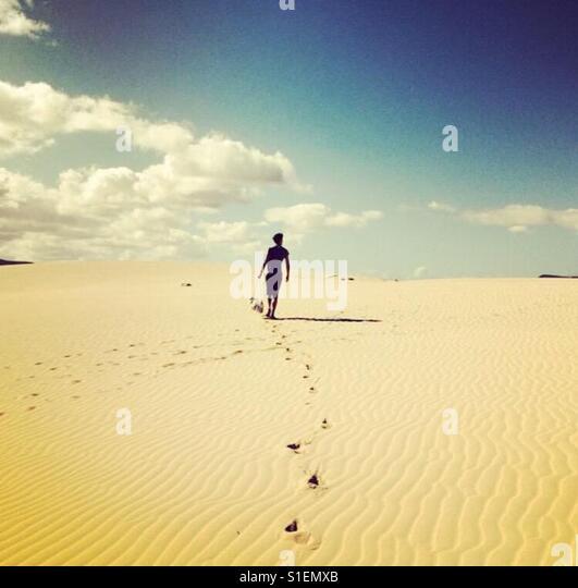 Walking in sand dunes - Stock-Bilder