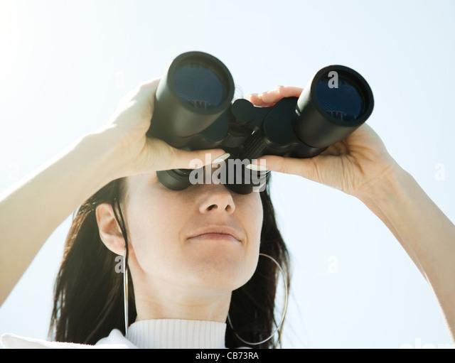 Girl with binocular - Stock Image