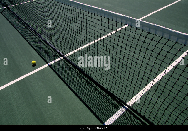 Tennis net and ball - Stock Image