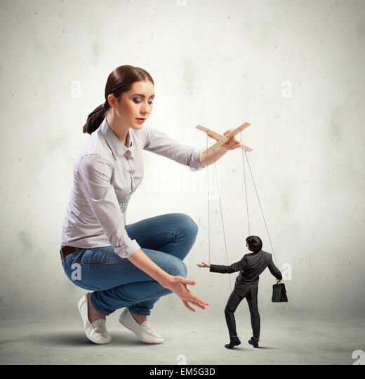 Businesswoman puppeteer - Stock-Bilder