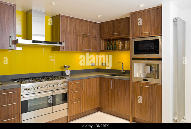 Shot of a Brand New Contemporary Walnut Kitchen - Stock Image