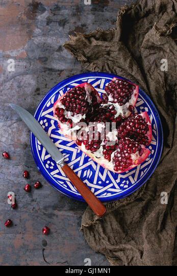 Sliced ripe pomegranate - Stock Image