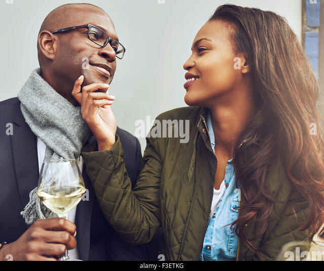 Black couple having a good time on a cafe in the spring - Stock Image