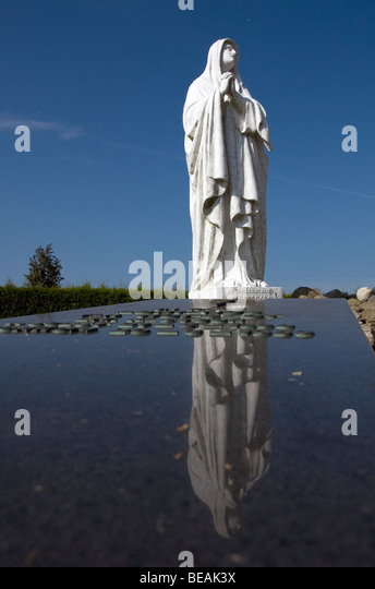 Maria Statue on graveyard monument in Workum, Fryslan, The Netherlands - Stock Image
