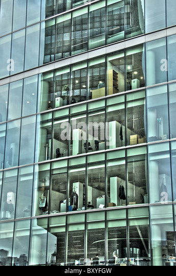 High rise building in London with offices seen through glass walls - Stock Image