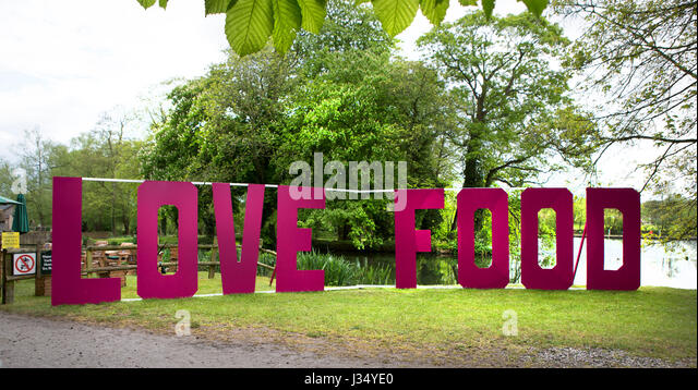 MAPLEDURHAM, UK - MAY 1, 2017: Love Food sign at the Mapledurham Foor Festival, Bank holiday Monday - Stock Image