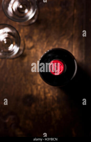 Bottle of red wine and two glasses on wooden table. Top view with copy space. - Stock-Bilder