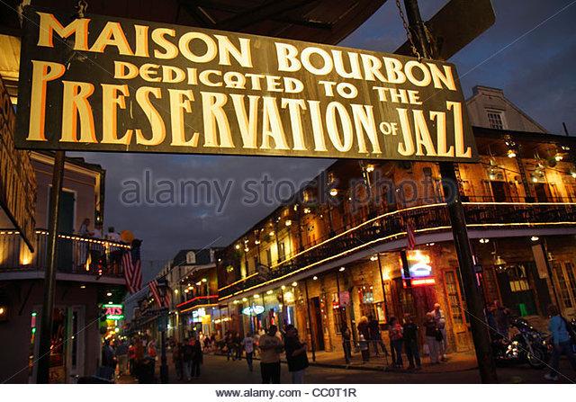 Louisiana New Orleans French Quarter National Historic Landmark street scene Bourbon Street Maison Bourbon business - Stock Image