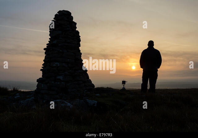 Baldersdale, County Durham UK. 10th September 2014.   UK Weather.  Hiker waiting for his stove to boil water for - Stock Image