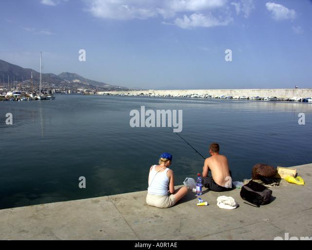 Anglers Fishing with Rod and Line Puerto Deportivo de Fuengirola Fuengirola Port Costa del Sol Spain - Stock Image