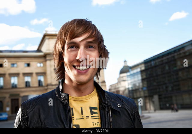 Portrait of a happy young man - Stock Image