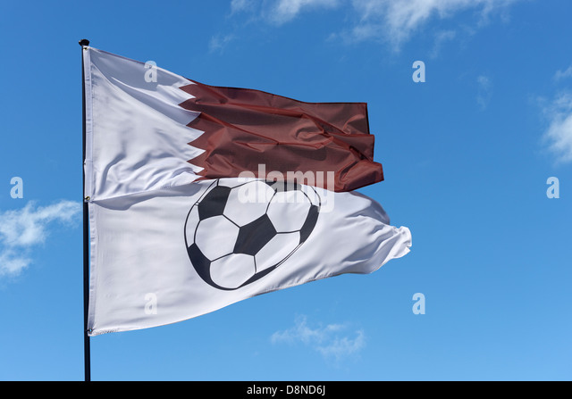 State of Qatar national flag and a football flag - Stock Image