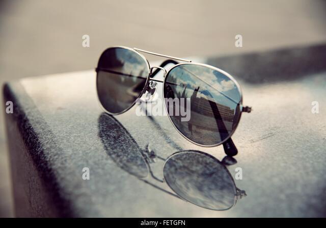 Reflection Of Building On Sunglasses - Stock-Bilder
