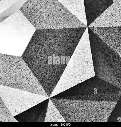 Abstract image of carved facets on block of granite - Stock Image