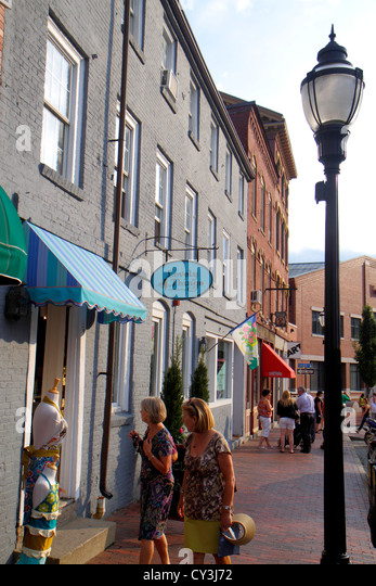 Portland Maine Historic Old Port District Fore Street businesses signs shopping woman lamppost - Stock Image