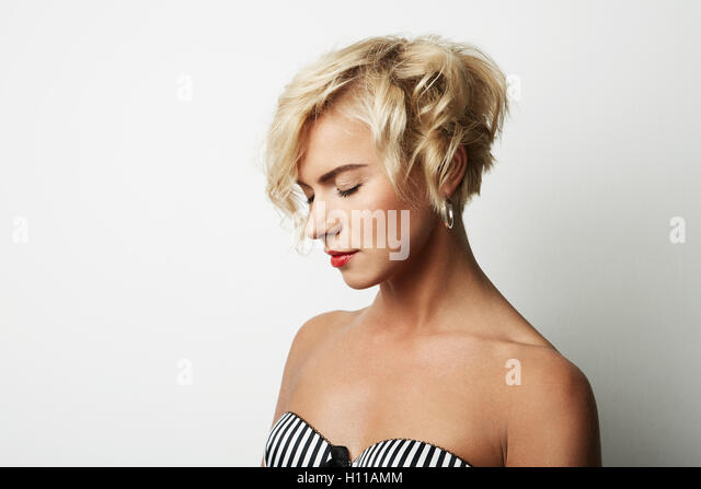 Portrait Handsome Young Woman Blonde Hair Wearing Dress Empty White Background.Beauty Fashion People Photo.Pretty - Stock Image