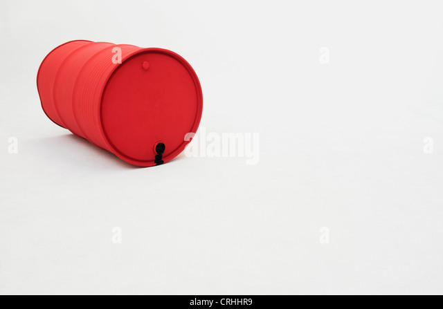 Metal oil drum lying on side - Stock Image