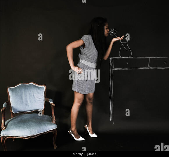 Optical Illusion Of Woman Smelling Flower Drawing On Wall - Stock-Bilder