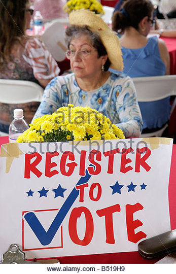 Miami Florida Tropical Park Cuban Exodus Relief Project festival political voter registration sign Hispanic woman - Stock Image