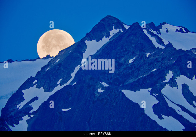 Moon set over the Olympic Mountains Olympic National Park Washington - Stock Image