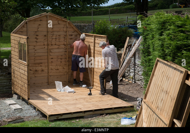 Two Construction Workers Putting Together Stock Photos