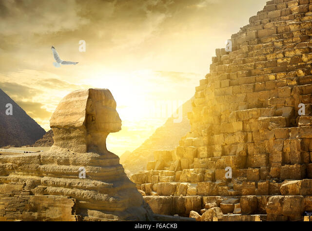 Great sphinx and pyramids under bright sun - Stock Image