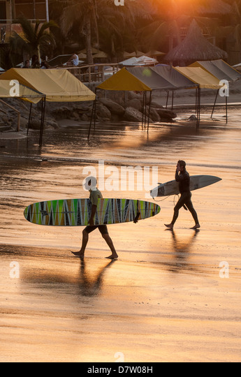 Surfing in Mancora, Peru, South America - Stock Image