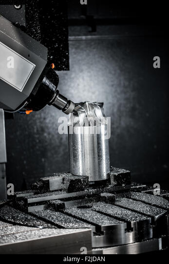 Metalworking CNC milling machine. Cutting metal modern processing technology. Small depth of field. Warning - authentic - Stock Image