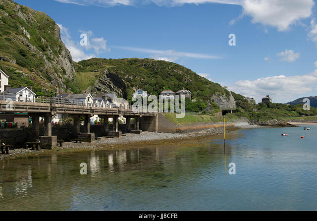 A view of the famous railway bridge over the estuary and harbour at Barmouth in Wales - Stock Image