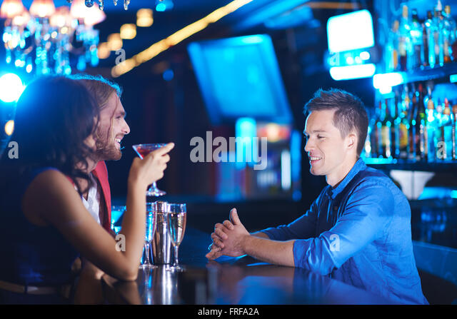 Talking by drink - Stock Image