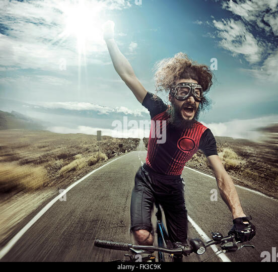 Portrait of a funny yelling bicyclist - Stock Image