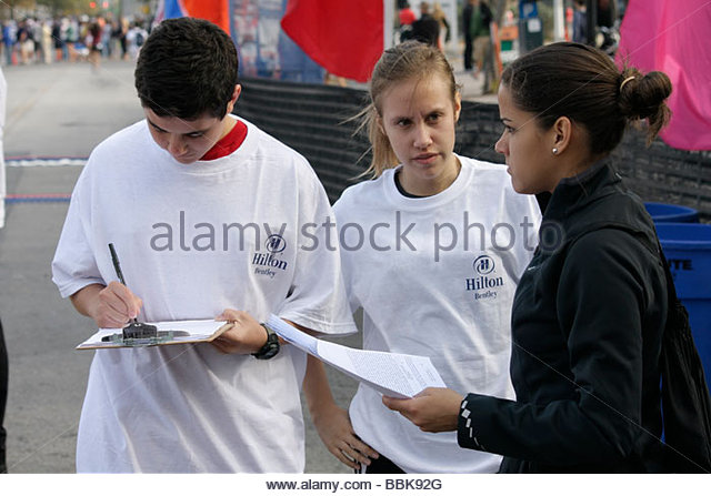 Miami Beach Florida Ocean Drive South Pointe 5K Run benefit runners race finish line teen student volunteer Hispanic - Stock Image