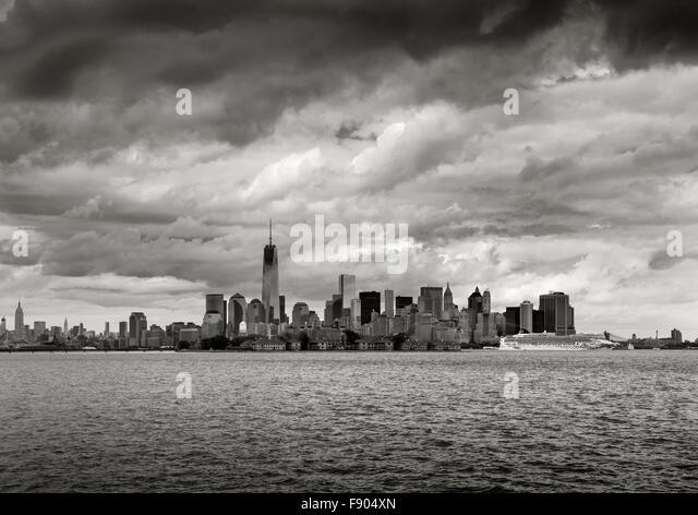 New York Harbor Black & White view of Lower Manhattan skyscrapers, New York. One World Trade Center rises towards - Stock Image