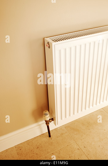 Standard Radiator mounted on a wall of a home. - Stock Image