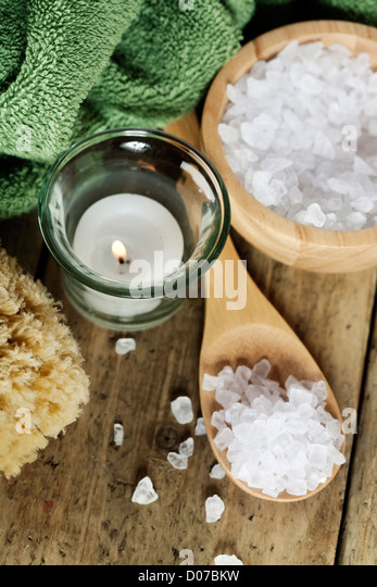 Spa Settings (candle, towel and sea salt) - Stock Image