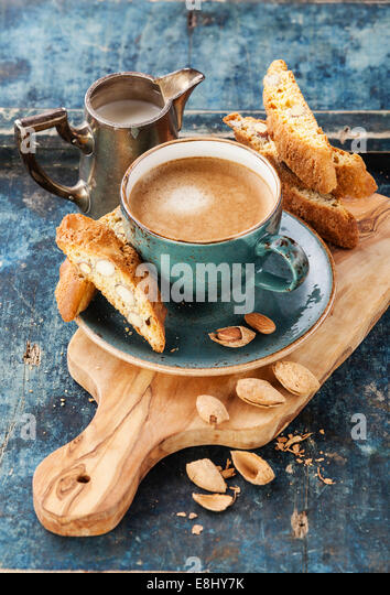 Coffee cup and cantucci on blue background - Stock Image