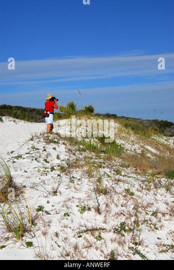 Florida Grayton Beach State Park sand dunes woman red shirt hiking nature trail - Stock Image