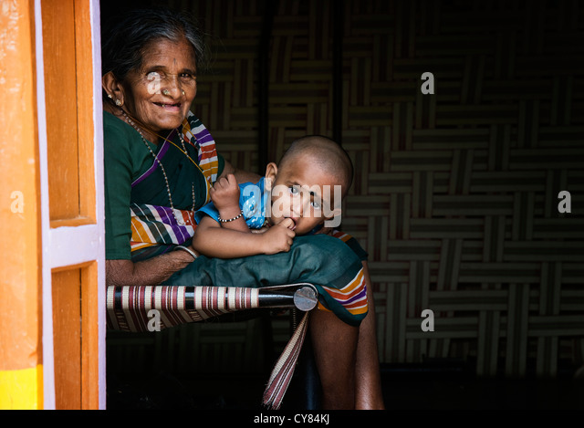 Rural Indian village Grandmother and grandson in there home. Andhra Pradesh, India - Stock Image