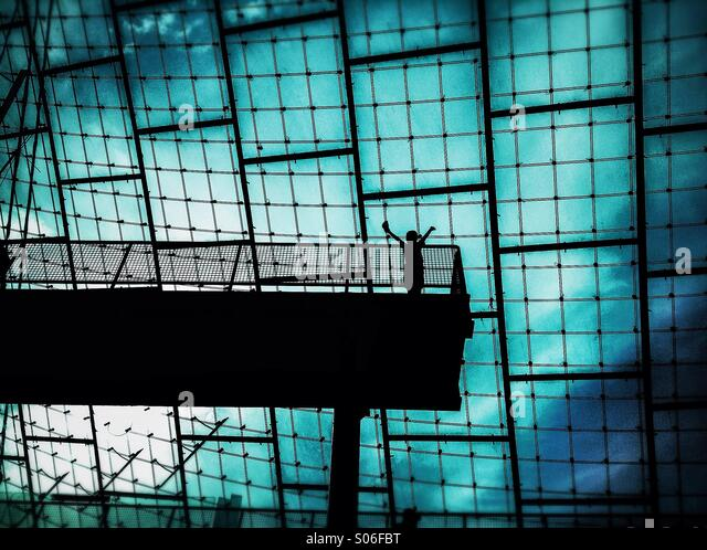 Silhouette of a person with the sign of victory in Olympic Stadium of Munich, Bavaria, Germany - Stock-Bilder