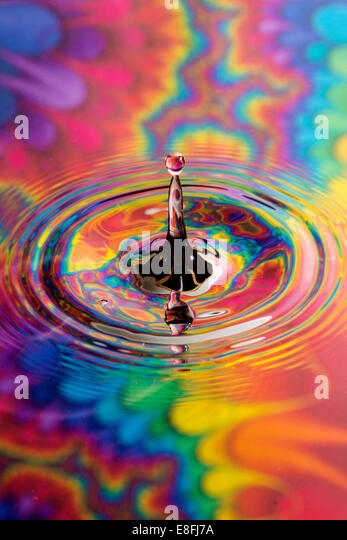 Water drop with colorful background - Stock-Bilder