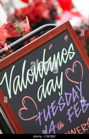 Sign Promoting Valentines Day Outside Florists Shop - Stock Image