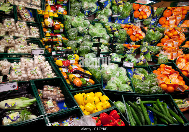 vegetable and fruit shelf  in a supermarket - Stock Image