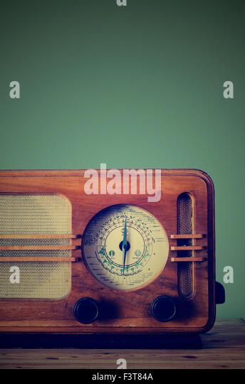 Antique radio on retro background - Stock Image