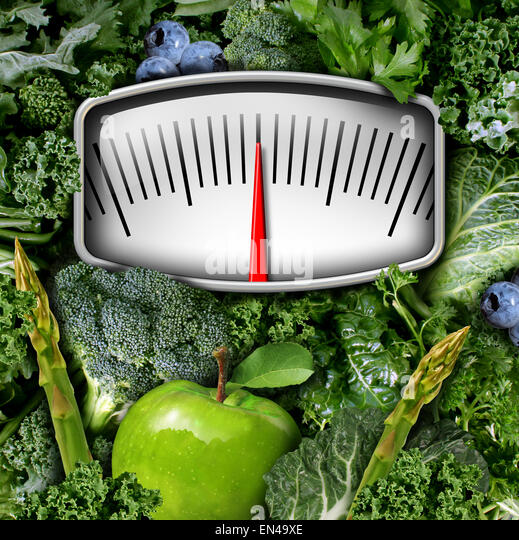Fruits and vegetables weight scale concept as a group of natural food as broccoli apple blue berries and green leafy - Stock-Bilder