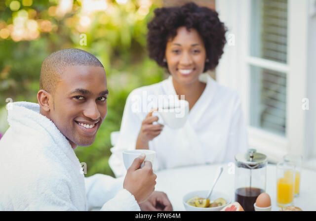 Happy couple having breakfast - Stock-Bilder