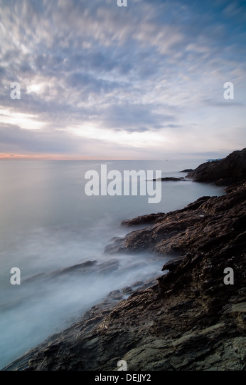 Blurred clouds and waves at sunrise at Ladies Cove Dartmouth - Stock-Bilder