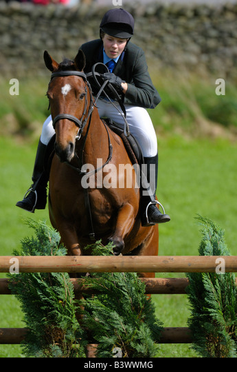 show jumping at a county fair - Stock Image